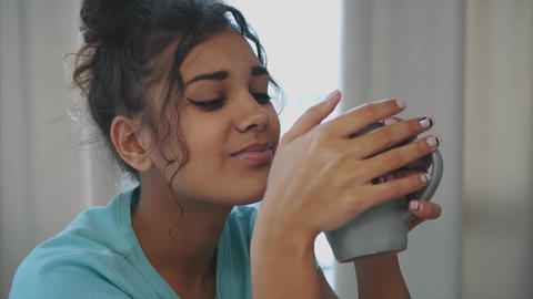 Gorgeous, beautiful, young woman holding glass of fresh water and smiling while Footage