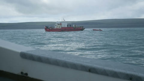 Epic view of fishing toristic boat at north summer Barents sea, stormy weather Footage