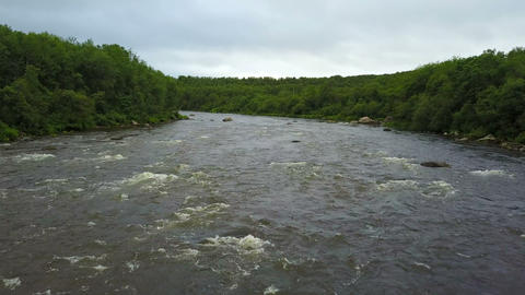 aerial flight under the fast water of salmon river Pechenga at the Kola Live Action