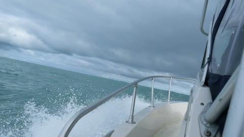 Horizon of north barents sea, slomotion waves under the motorboat Footage