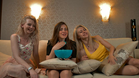 Three wonderful women watch movie pose to camera with smile on their face and Footage