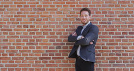 Successful Proud Businessman Portrait Outside On Brick Wall Background Footage