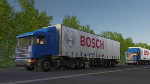 Freight semi trucks with Robert Bosch GmbH logo driving along forest road Live Action