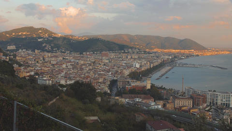 City on a sea shore and marina with yachts during sunset. Panorama of Salerno GIF