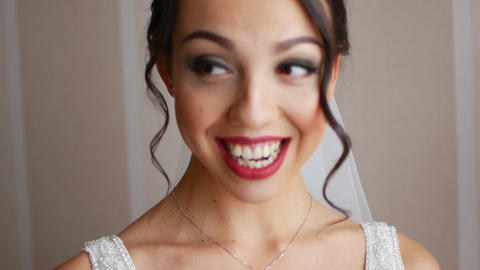Portrait of the beautiful gorgeous bride with lovely smile is laughing and Footage