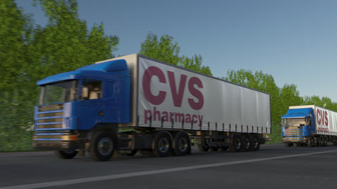 Freight semi trucks with CVS Health logo driving along forest road, seamless Footage