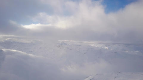 Panoramic winter view of beutifully presented long snowcapped mountain chain Footage