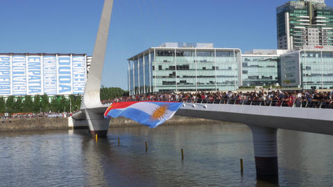 Argentinian and Chinese waving flag at the Woman Bridge in Madero Harbor for the Footage