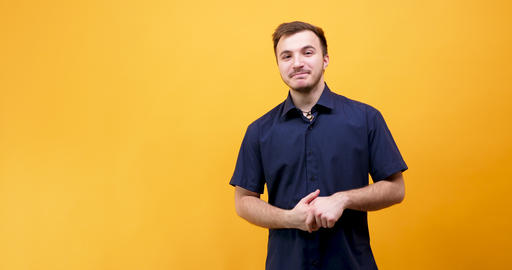 Happy positive guy on yellow background Footage