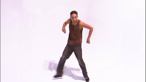 Break dancer doing a knee slide Live Action