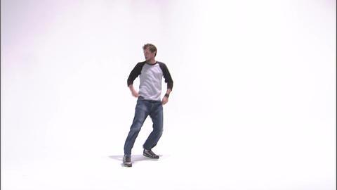 Break dancer spinning a one-handed handstand Live Action