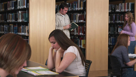 Students studying at a library Footage