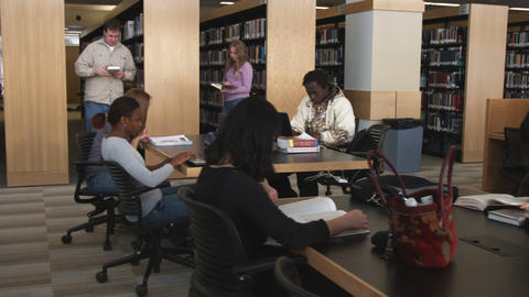 Students in a library studying Footage