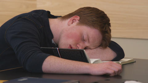 Close-up of a student sleeping while reading Footage