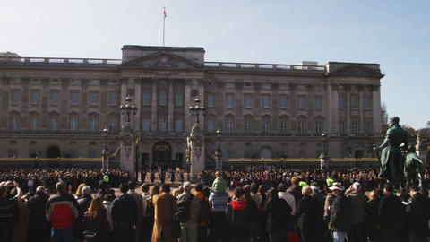 Pan of the changing of the guards at Buckingham Palace in London Footage