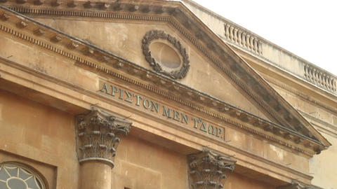 Greek writing on a building in England Footage