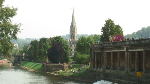 Top of a cathedral and boats in a river in England Live Action
