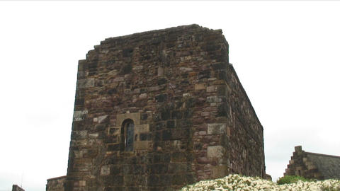 Shot of an old square stone tower in Edinburgh Scotland Footage