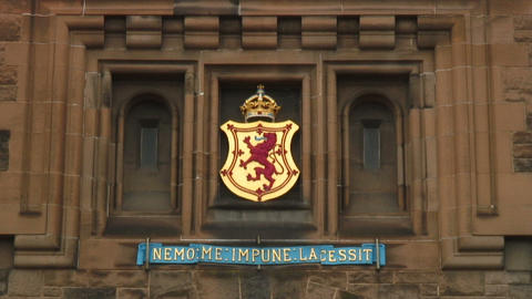 Coat of arms with Latin words on a building in London Footage