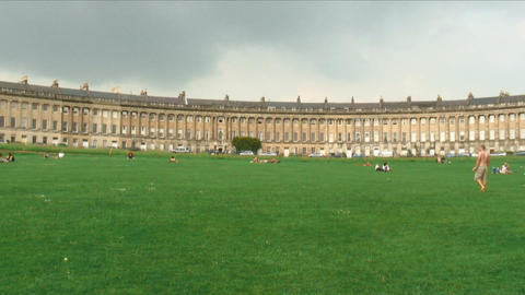Royal Crescent and people on the lawn in Bath England Live Action