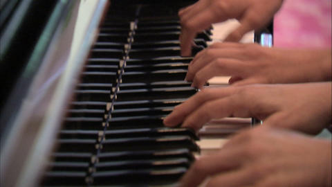 Multiple hands playing the piano Footage