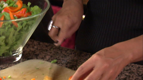 Tilt down shot of a couple preparing a salad Footage