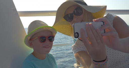Mother and son taking selfie during sea travel Live Action