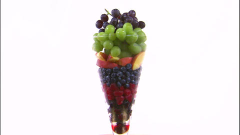 Assortment of fruit in a vase on a white screen Live Action