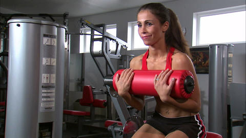 Woman doing sitting curls Footage