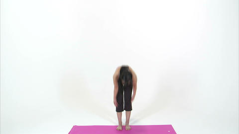 Woman doing yoga on a pink mat Live Action