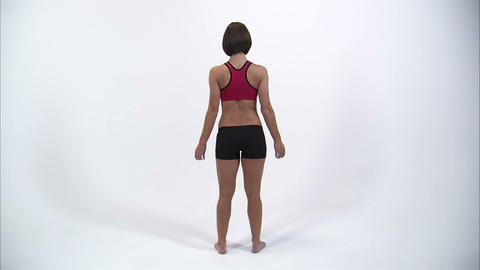Back of a woman as she puts her hands on her hips Footage