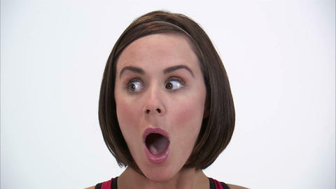 Close-up of a woman giving a surprised expression on a white background Footage