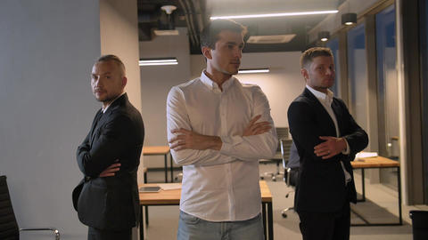 shot of three confident attractive handsome colleagues entrepreneurs Footage