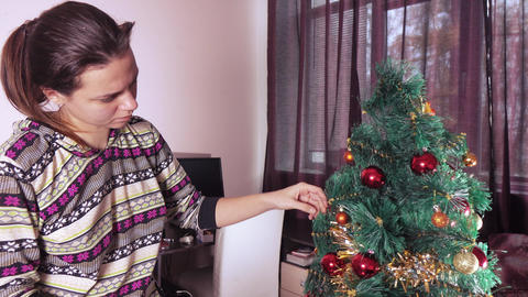 Girl decorates the Christmas tree Footage