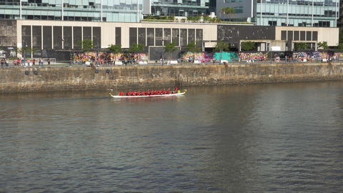 Dragon row boat returning to starting line Footage