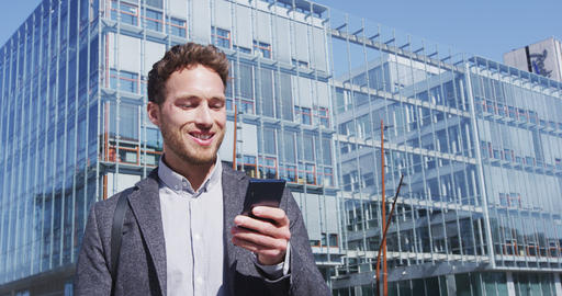 Businesspeople - Man sms texting using app smart phone in city Live Action