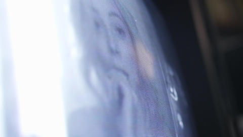 Surface of old TV monitor displaying blonde girl putting fingers into mouth Footage
