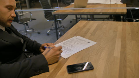 Customer signing employment contract in office during the meeting Footage