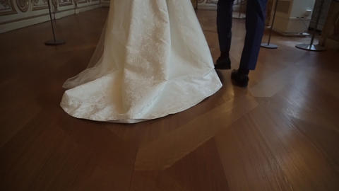 The bride and groom walk on the wooden floor indoors 영상물