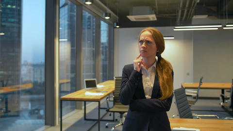 Young buusiness lady standing inside of the office and thought and dreaming Live Action