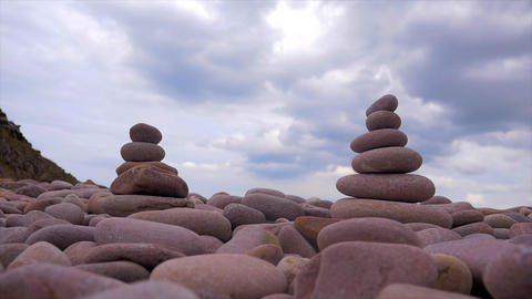 Stones pyramid on pebble beach, symbolizing zen, harmony, balance,motion Archivo