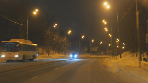 Cars drive on the night winter road Footage