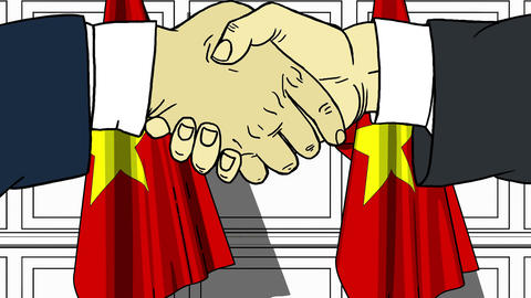 Businessmen or politicians shake hands against flags of Vietnam. Official Footage