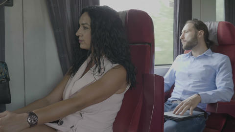 Business man and elegant passenger woman traveling on train man using digital Footage