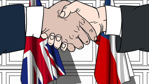 Businessmen or politicians shake hands against flags of Great Britain and the Live Action