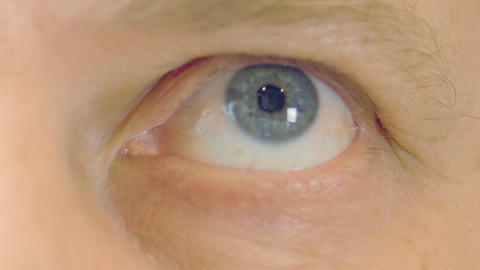 Close up human eye looking and moving. Macro shooting eye of senior man Footage