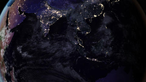 Night side of the Earth with city lights. Zoom in Asia countries: China, India Animation