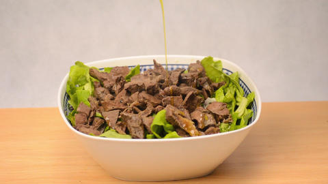 Olive Oil Poured Over Meat Salad Footage