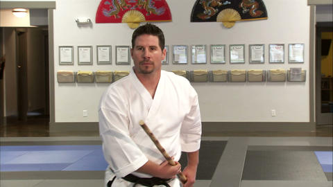 Close up of a martial arts instructor using a bo staff Live Action