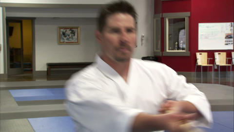 Close up of a martial artist using a bo staff and bowing Footage